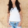 Slender brunette white cap jeans — Stock Photo