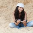 Woman sitting sand reading book — Stock Photo