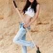 Stock Photo: Young brunette shovel