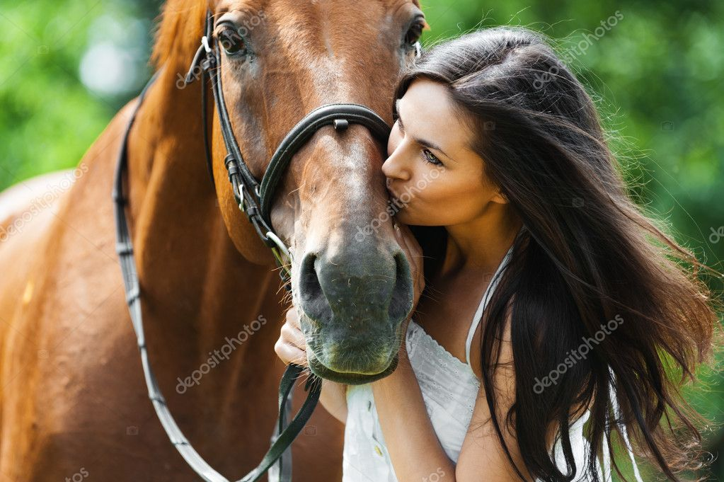 Woman long hair kissing beautiful horse — Stock Photo #7340813