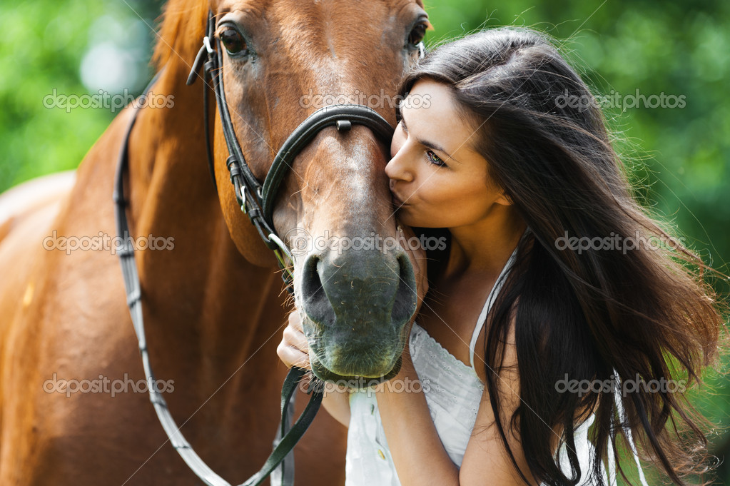 horse kissing woman
