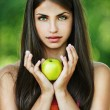 Portrait pretty serious woman hands yellow apple — Stock Photo