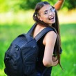 Attractive woman glasses rucksack back — Stock Photo