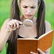 Portrait serious beautiful woman magnifier book — Stock Photo