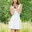 Slim beautiful young woman standing white dress — Stock Photo
