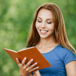 Portrait beautiful woman reading book — Stock Photo #7362094