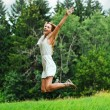 Fun happy young woman jumping up — Stock Photo