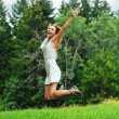 Fun happy young woman jumping up - Stock Photo