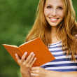 Portrait beautiful woman reading book — Stock Photo