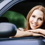 Young beautiful young woman sitting car — Stock Photo