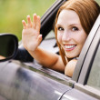 Pretty young woman sitting car looking out window — Stock Photo #7362123