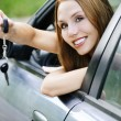 Portrait young attractive woman sitting salon automobile hand ke — Stock Photo