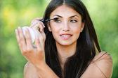 Portrait beautiful woman bare paints eyelashes — Stock Photo