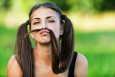 Portrait cheerful funny young woman two long tail — Stock Photo
