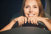 Portrait beautiful young woman sitting saloon car — Stock Photo