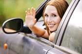 Pretty young woman sitting car looking out window — Stock Photo