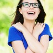 Young girl glasses looking up - Stock Photo