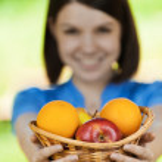 Beautiful girl basket fruit — Stock Photo