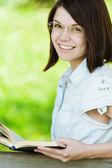 Portrait young pretty girl glasses book — Stock Photo
