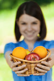 Beautiful girl basket fruit — Stock Photo