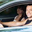 Handsome man and woman sitting car — Stock Photo