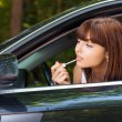 Portrait beautiful woman car paints lips - Stock Photo