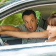 Pretty young couple sitting car surprised — Stock Photo