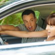 Pretty young couple sitting car surprised — Stock Photo #7475818