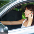 Young woman sitting car talking phone — Stock Photo