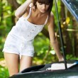 Beautiful young woman next car — Stock Photo #7475831