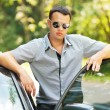 Attractive young serious man car - Stock Photo