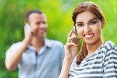 Portrait young beautiful happy couple talking phone — Stock Photo