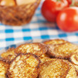 Stock Photo: Closeup delicious fried fritter, twig red tomatoes,wicker basket