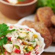 Delicious dinner closeup bowl(crab salad,burgers,borscht) — Stock Photo