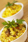 Closeup two portion yummy pilaf (rice,meat,pork,carrot)decorated — Stock Photo