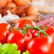Foods (tomatoes, lettuce, garlic,sausage, spices, eggs) — Stock Photo #7576274