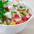 Closeup crab salad with parsley decorated — Stock Photo
