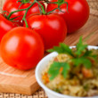 Pilaf (rice, carrots, meat, parsley), tomato twig — Stock Photo