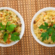 Pilaf (meat, carrots, rice) decorated parsley - Stock Photo