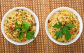 Pilaf (meat, carrots, rice) decorated parsley — Stock Photo