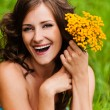 Portrait young gay beautiful woman holding bouquet yellow wildfl — Stockfoto #7581589