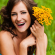 Portrait young gay beautiful woman holding bouquet yellow wildfl — Stock Photo #7581589