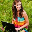 Woman young beautiful laptop headphones — Stock Photo #7581598
