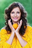 Portrait young charming woman holding tangerine — Stock Photo