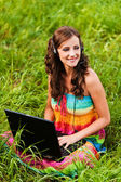 Woman young beautiful laptop headphones — Stock Photo