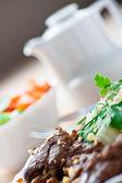 Stew meat, vegetable salad — Stock Photo