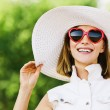 Royalty-Free Stock Photo: Portrait young charming woman white hat red sunglasses