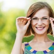 Portrait beautiful young woman funny glasses — Stock Photo