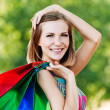 Portrait young charming short-haired woman shopping — Stock Photo