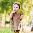 Portrait little cute girl holding finger mouth — Stock Photo #7763839